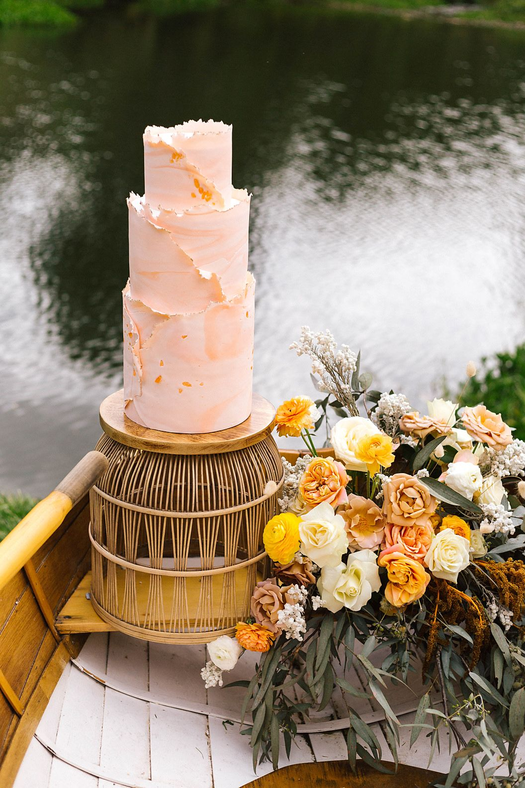 Three-tiered boho wedding cake with marbled texture and deckle edge in peach and coral hues   Romantic Riverside Boho Wedding Inspiration   Photography: Poppy and Sage
