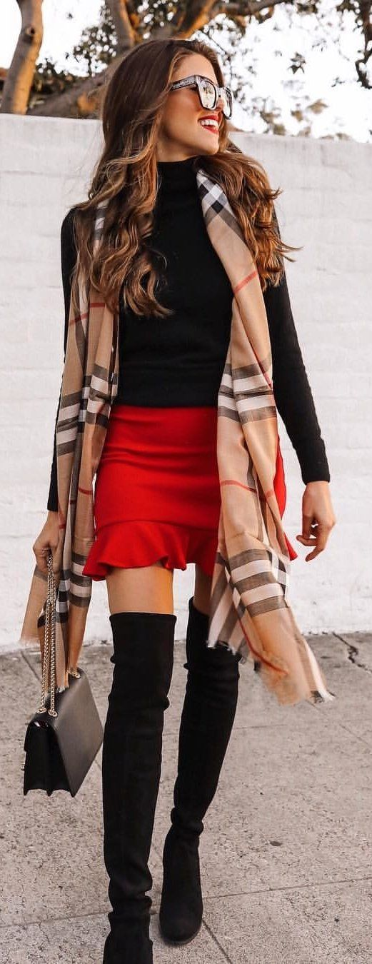 black long-sleeved shirt and red skirt