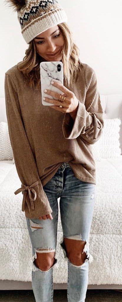 brown long-sleeved blouse