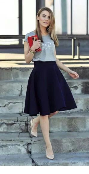 Grey top and a navy midi skirt