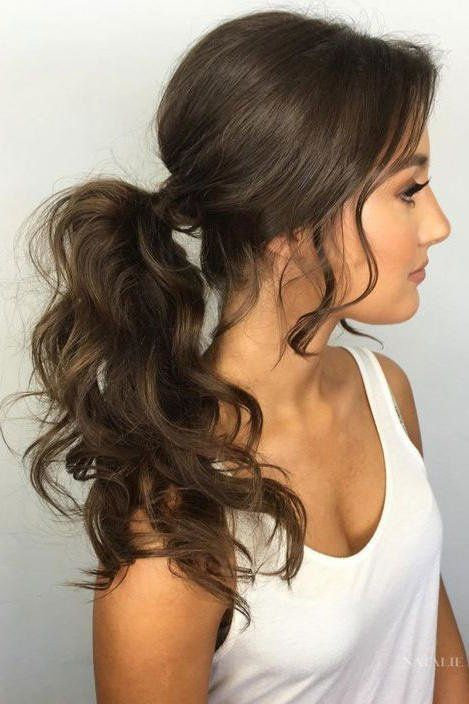 10 Festive Updos For Curly Haired Girls: Voluminous Pony