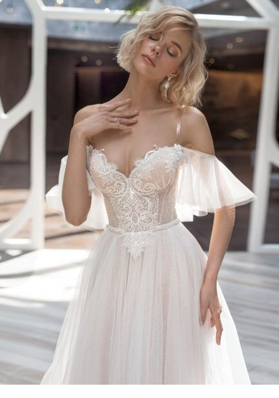 I like this wedding dress with sleeves