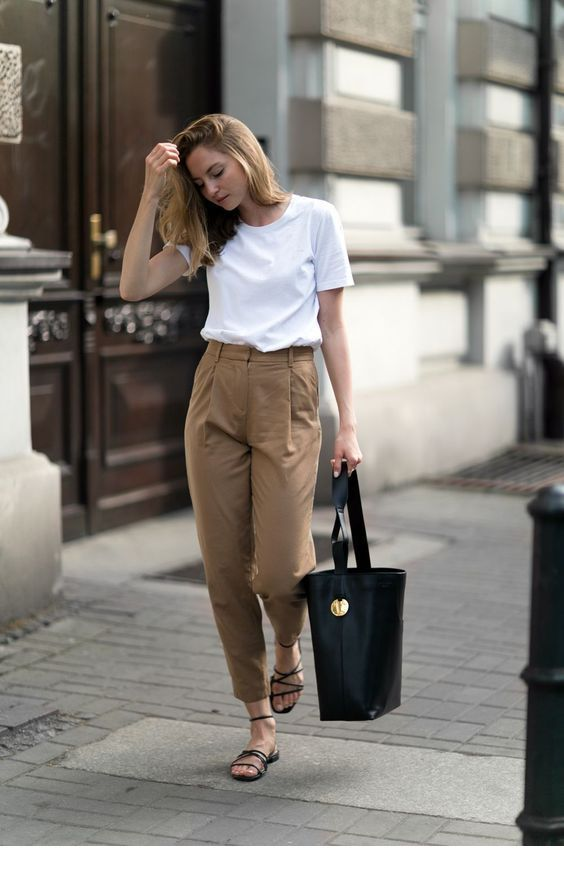 White top, brown pants and black accessories