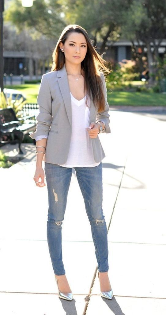 White top, grey blazer, jeans and silver shoes