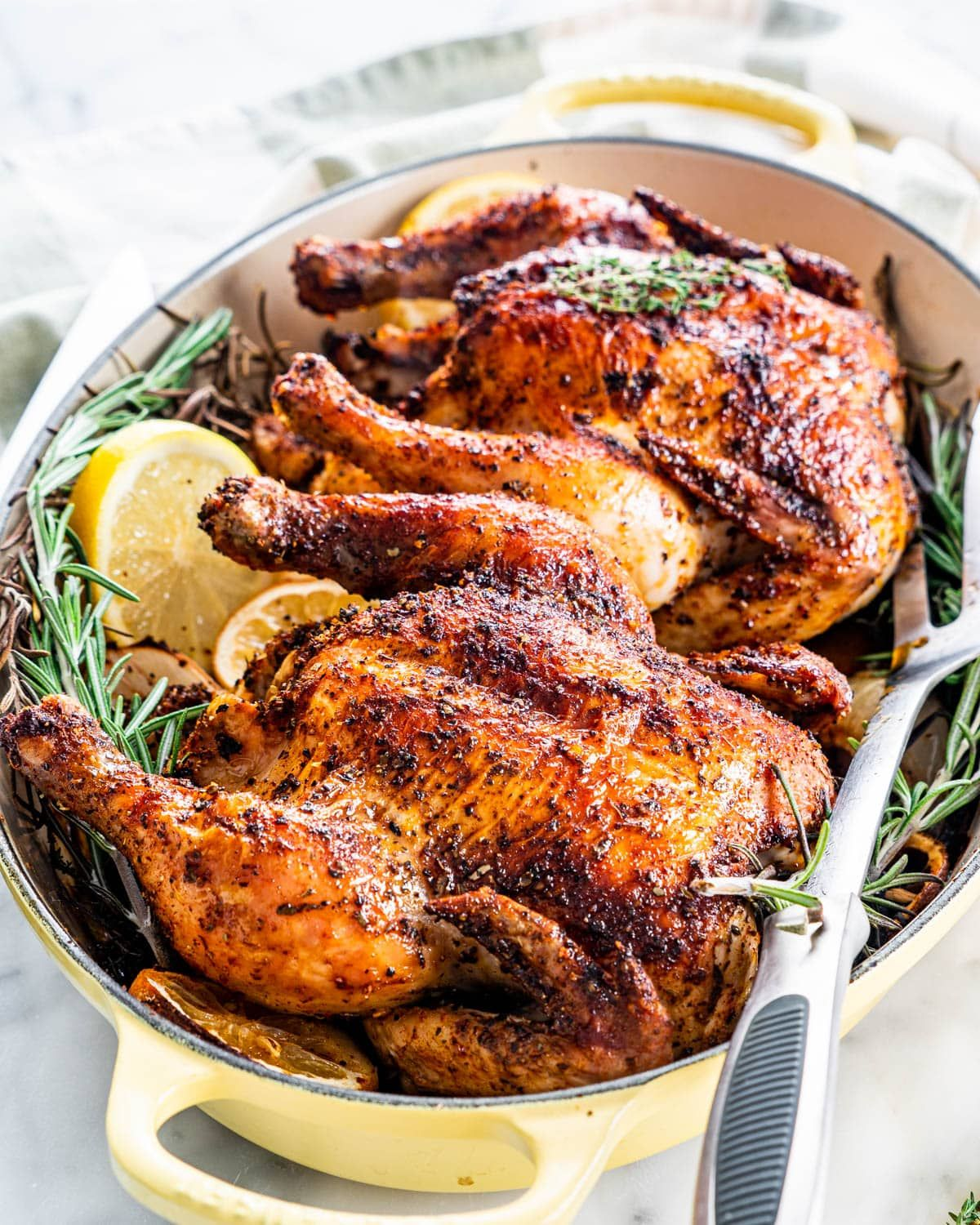 These Roasted Cornish Hens will be your new favorite recipe for romantic date nights or to impress dinner party guests. They're simple, elegant, and turn out perfectly every time with my easy step-by-step instructions. #cornishhens #roastchicken