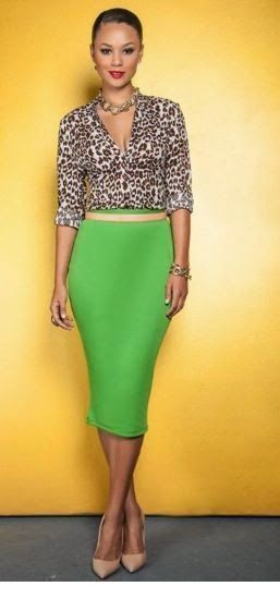 Leo shirt and green skirt