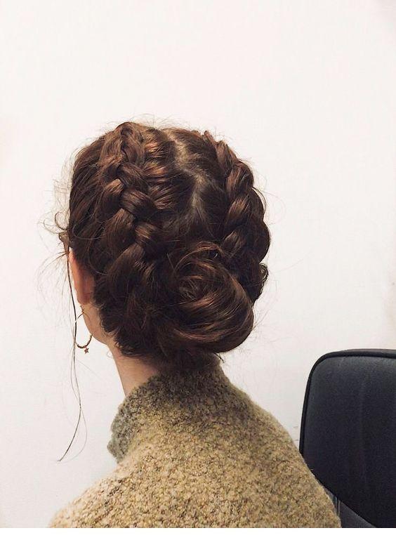 Large braids and rose bun