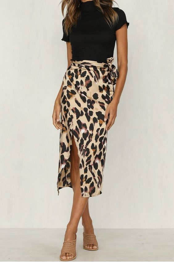 Black top and chic printed skirt