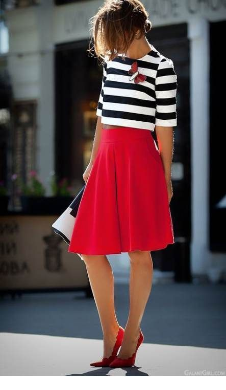 Cute black and white blouse and red midi skirt
