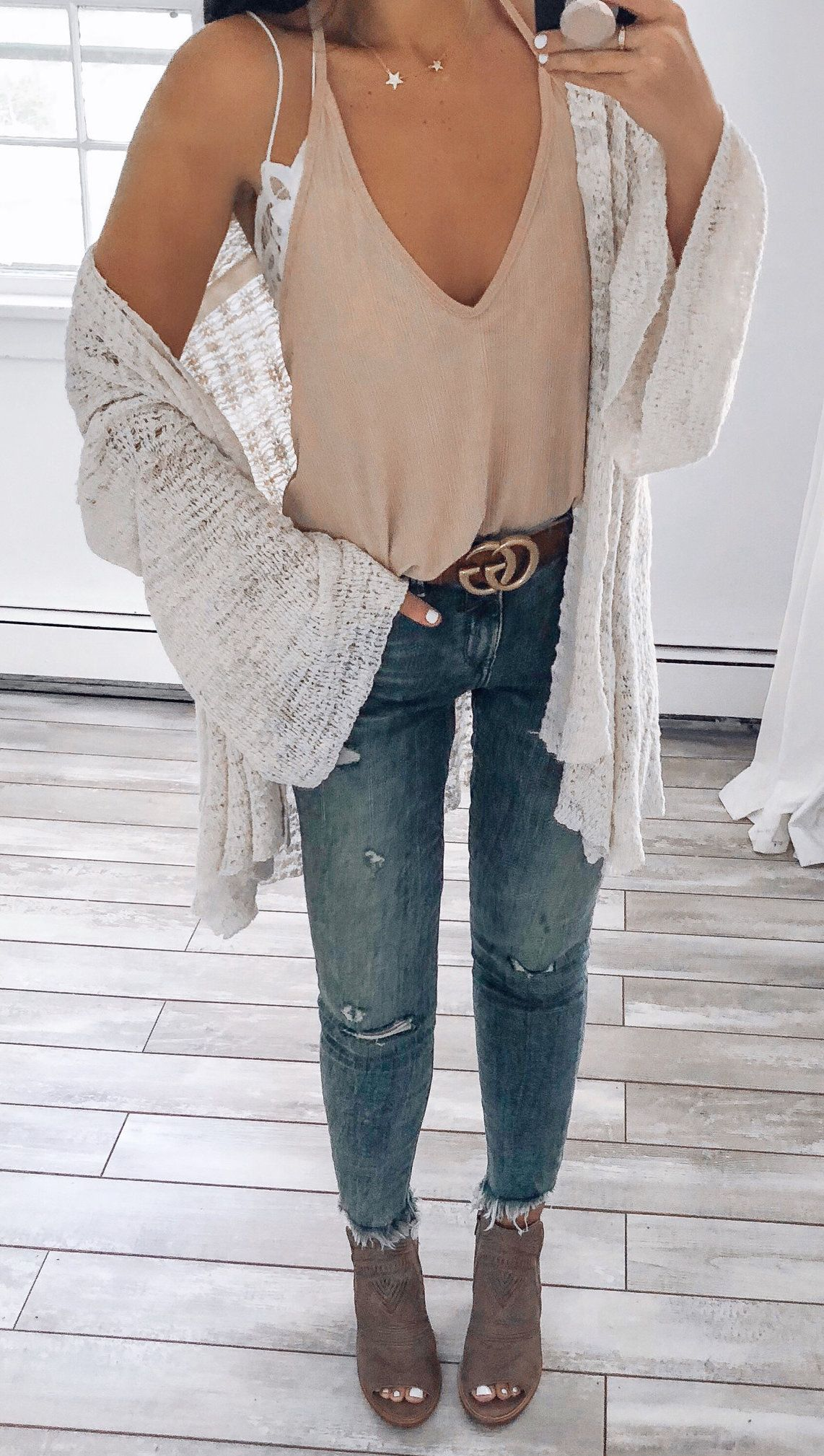 brown deep V-neck top, white cardigan, and blue distressed fitted jeans #spring #outfits