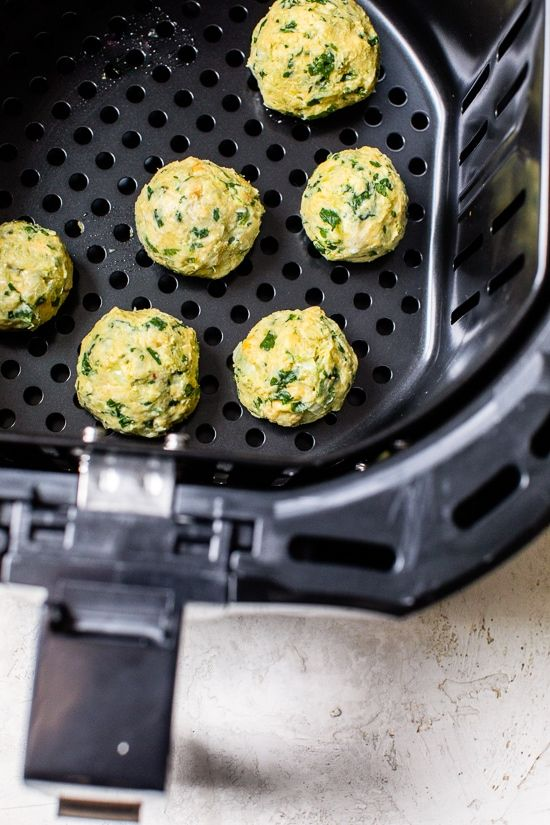 This easy Falafel recipe is made quicker and healthier in the air fryer with canned chickpeas – no deep frying! #airfryerrecipe #falafel #skinnytaste