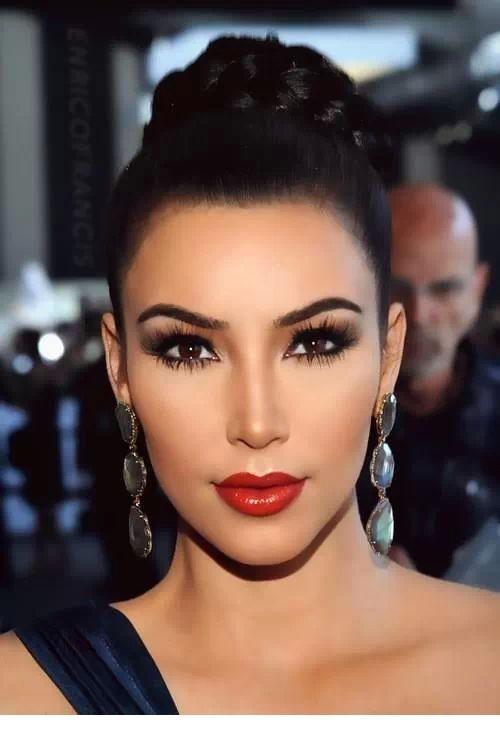 Long earrings, red lips and top bun