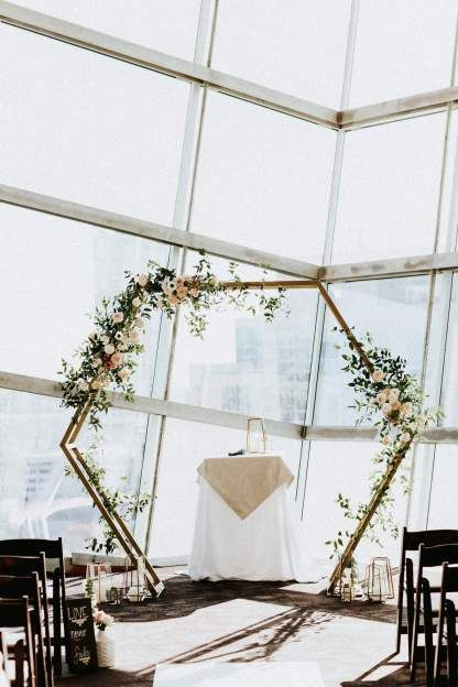 Downtown San Diego wedding held at the Central Library, loving this modern geometric hexagon arch