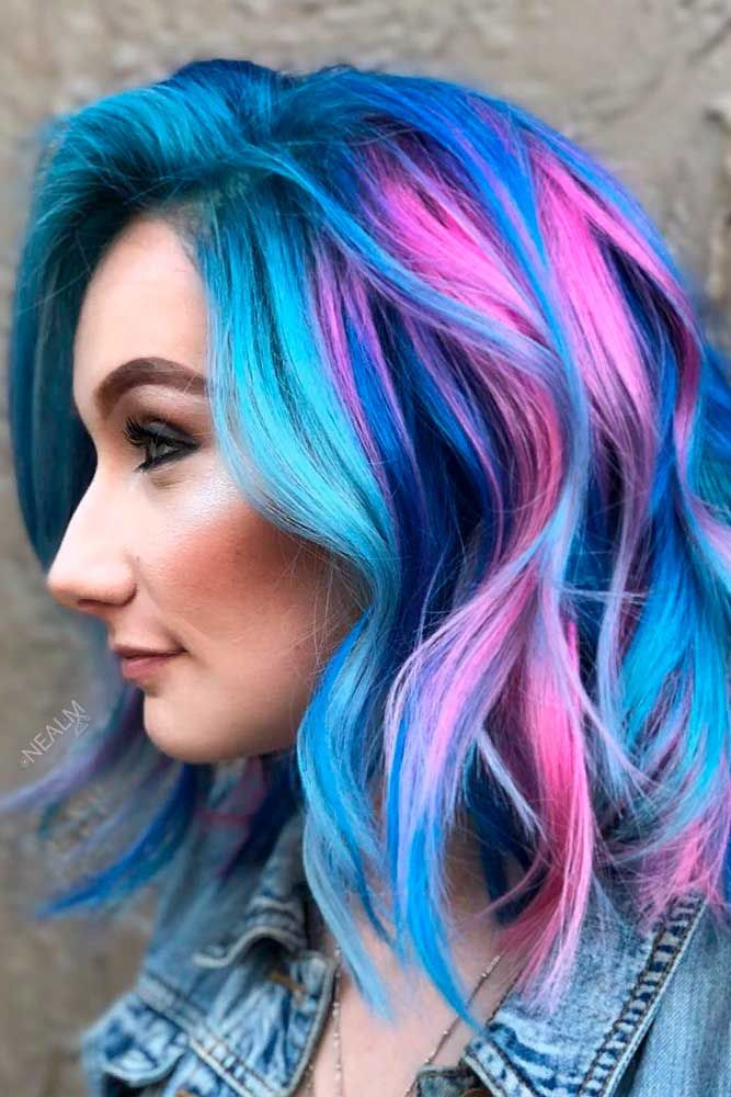 Bright Colored Hairstyle #colorfulhair #wavyhairstyle ★ Medium length hairstyles have a big number of perks, and that is why women all around the world choose to sport them. Any woman can find a flattering style for her. To help you do that, we have created a photo gallery featuring the most complimenting styles. Check it out and pick a new style. #glaminati #lifestyle #mediumlengthhairstyles