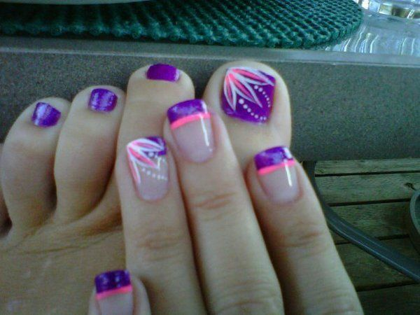 Violet, pink and white themed French tip nails and toenail art design. Match your hands and toes with this adorable looking violet explosion. The toenails are coated in violet nail polish as base coating. The big toenail is painted on top with pink and white petals plus polka dots.