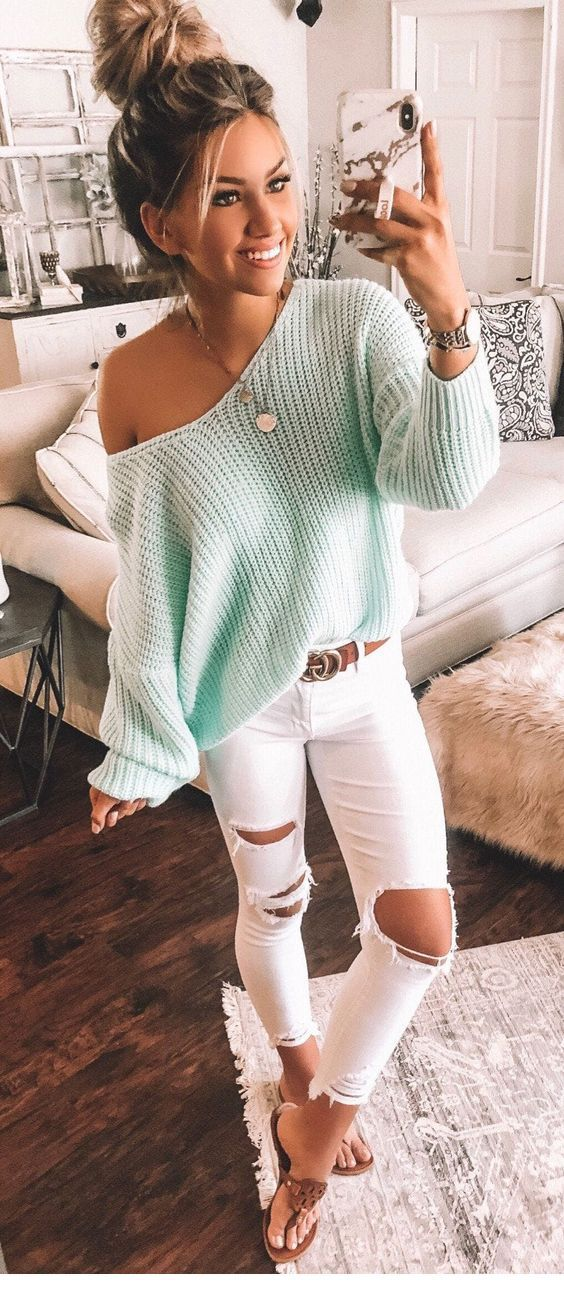 Very cute light blue sweater with white pants