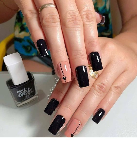 Chic black manicure with hearts