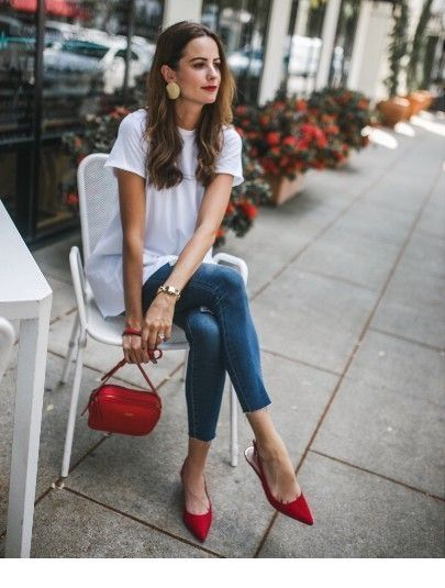 White top, jeans and red accents