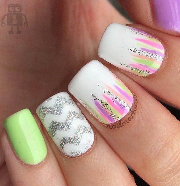 Soothing colors and glitters would make your Chevron nail look extra fun.
