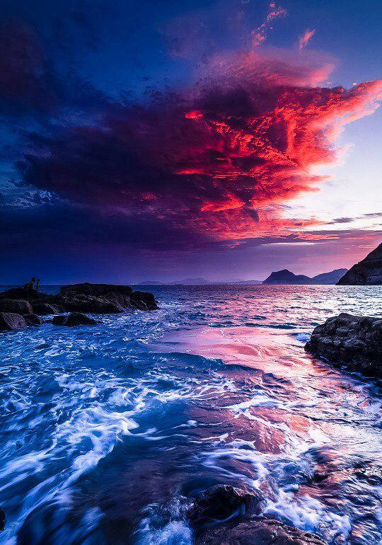 Fantastic coastal sunset. Landscape photography. Blues, reds and purple.