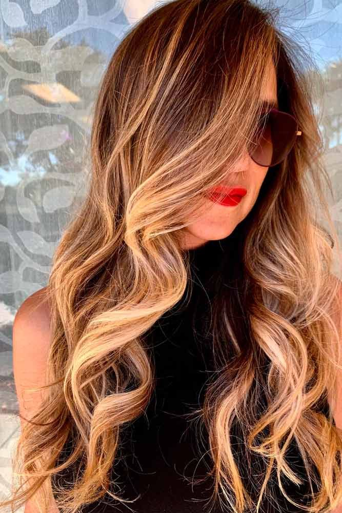 Polished Ringlets With Highlights #highlightshairstyles #curlyhair ★ Explore trendy long haircuts with layers for women. We have ideas for wavy, straight, thin and for thick hair. #glaminati #lifestyle #longhaircuts