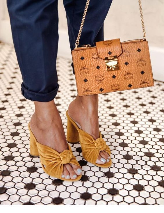 Cool yellow shoes with navy pants
