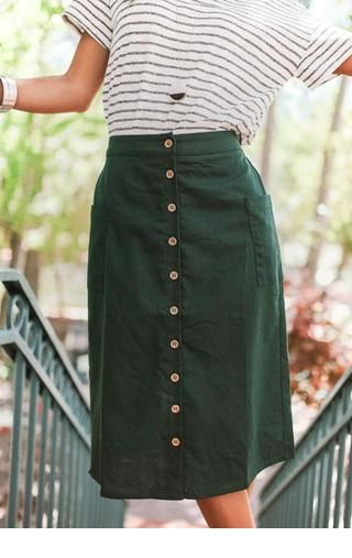 Simple t-shirt and a green skirt