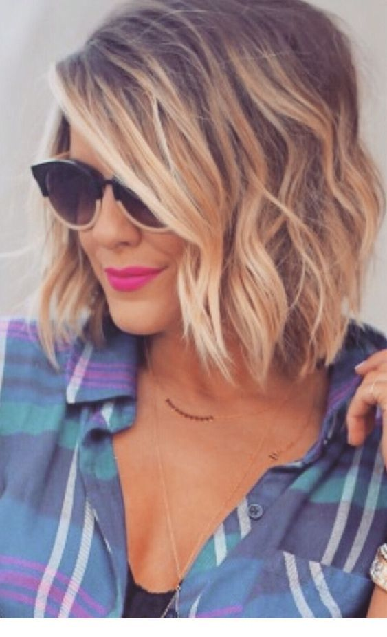 Short messy blonde hair and plaid shirt