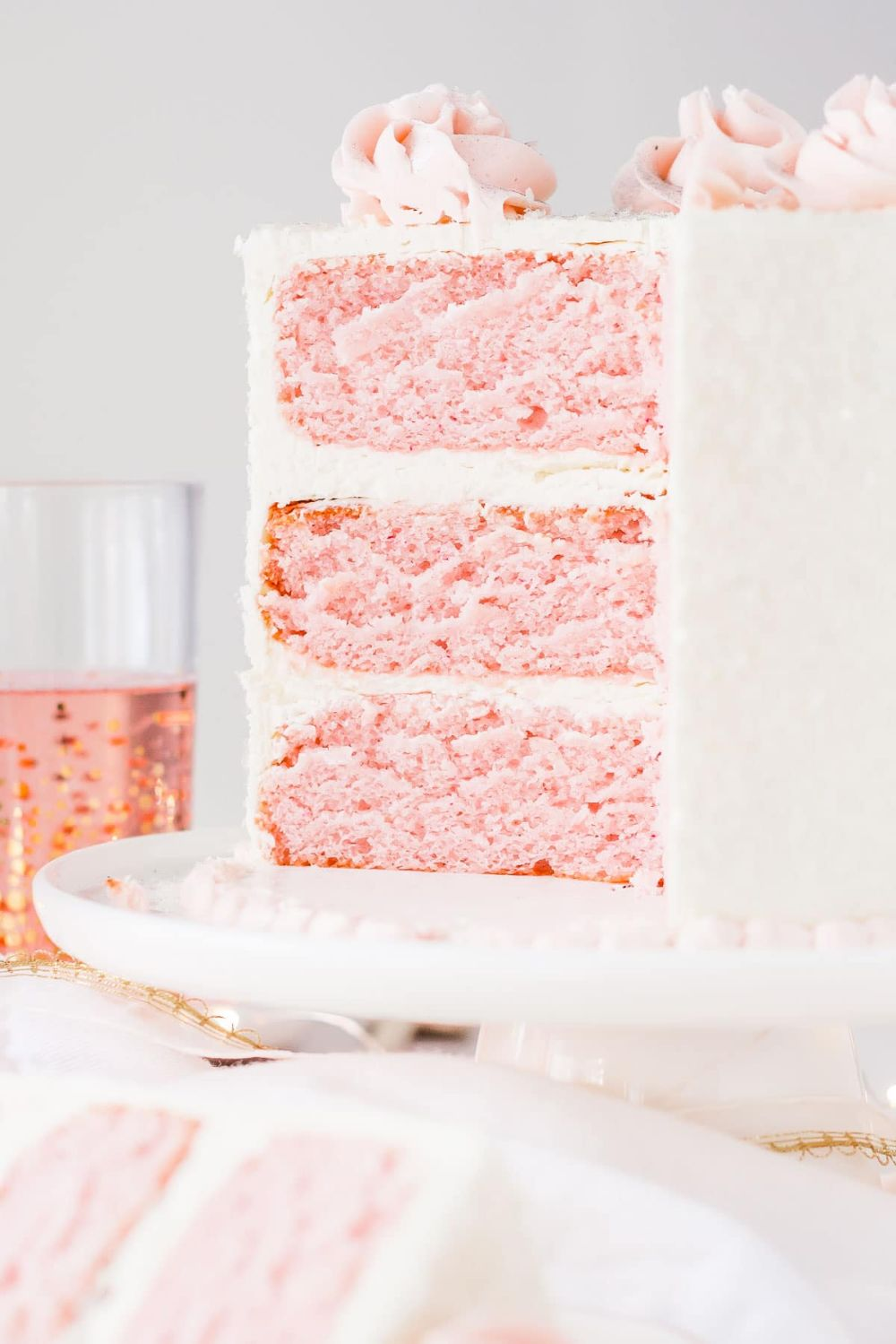 Cross section of pink champagne cake with vanilla buttercream.