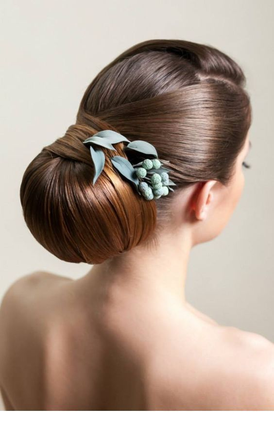 Low bun with a flower
