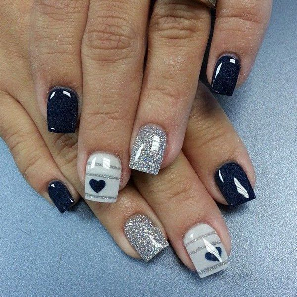 Cute and minimalist glitter nail art design consisting of matte glitter nails in silver and stripes on top of gray and midnight blue polishes.