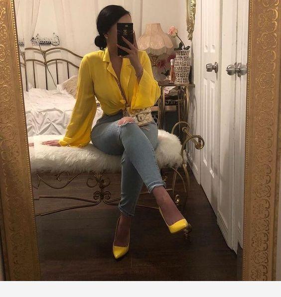 Yellow shirt and stilettos