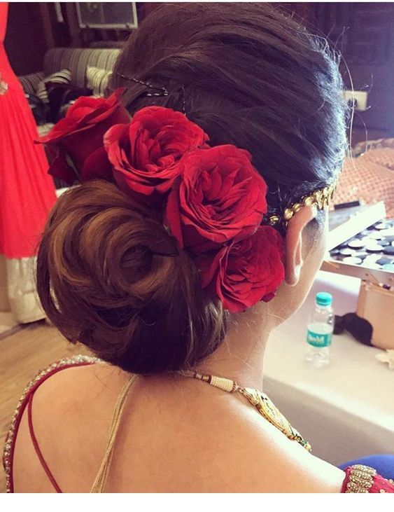 Brown hair, low bun and red roses