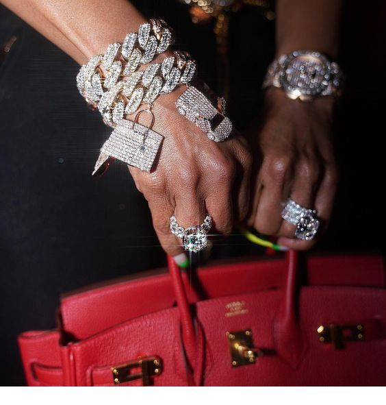 Glam accessories and a red bag