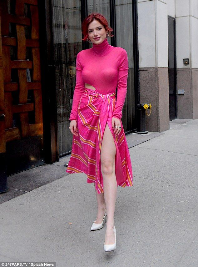 Bella Thorne dazzles in thigh baring pink wrap skirt in New York | Daily Mail Online