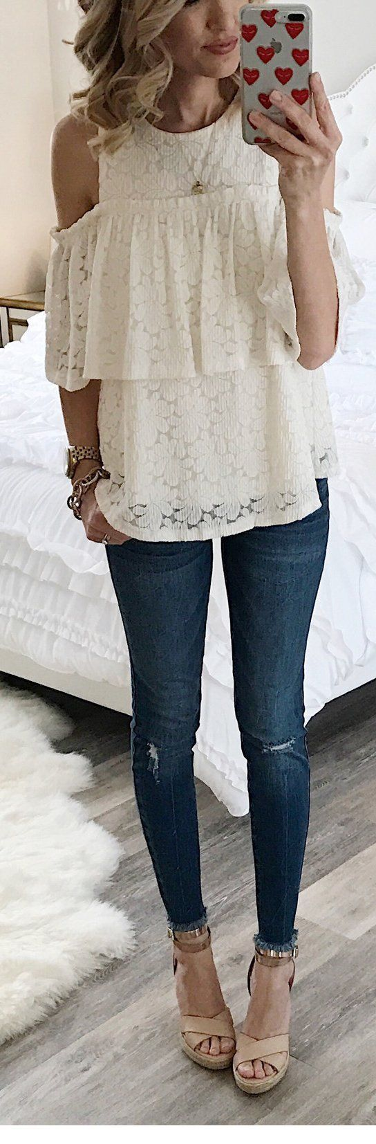 Romantic white lace top with blue jeans