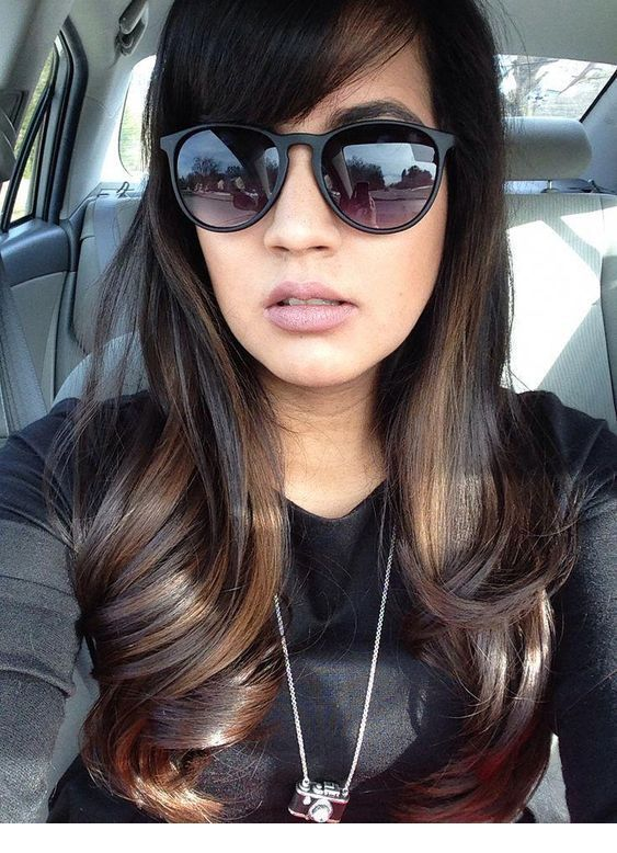 Amazing brown hair color and big sunglasses