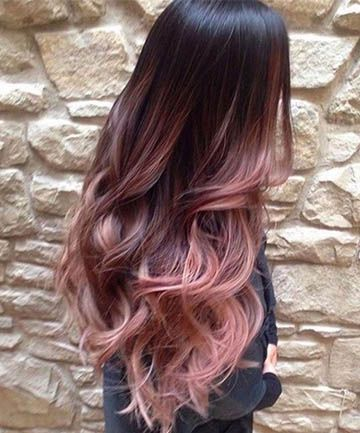 Cascading Pink Waves with Ombre Bayalage: Going for rose gold tones doesn't necessarily mean you have to bleach your entire mane platinum — if you go for an ombre bayalage look like this with a dip-dye effect, it means you'll only have to lighten the lower half of your hair.