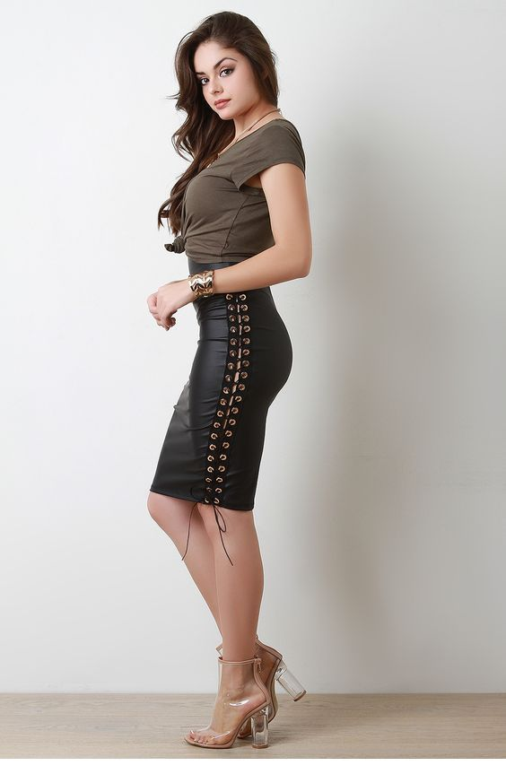 Grey top and leather skirt
