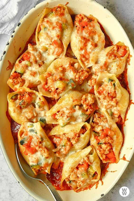 Turkey-veggie bolognese stuffed shells: Diced zucchini, fennel, onion, and carrot amps up an otherwise straightforward meat sauce made with ground turkey breast, then gets stuffed into jumbo pasta shells, topped with mozzarella, and baked till bubbly and gooey. It's guaranteed to be a family favorite.