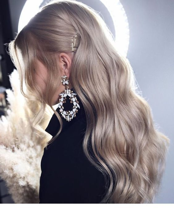 Sweet blonde hair and big earrings