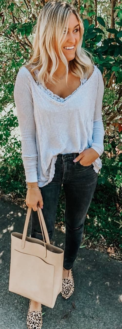 white V-neck long-sleeved shirt