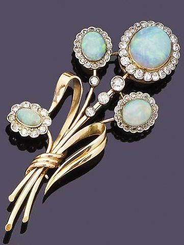 "An opal and diamond spray brooch Each flowerhead set with a central oval cabochon opal within an old brilliant or rose-cut diamond surround, to polished stems and leaves, old brilliant-cut diamonds approx. 0.95ct. total, length 7.8cm. <a class=""pintag"" href=""/explore/diamondbrooches/"" title=""#diamondbrooches explore Pinterest"">#diamondbrooches</a><p><a href=""http://www.homeinteriordesign.org/2018/02/short-guide-to-interior-decoration.html"">Short guide to interior decoration</a></p>"