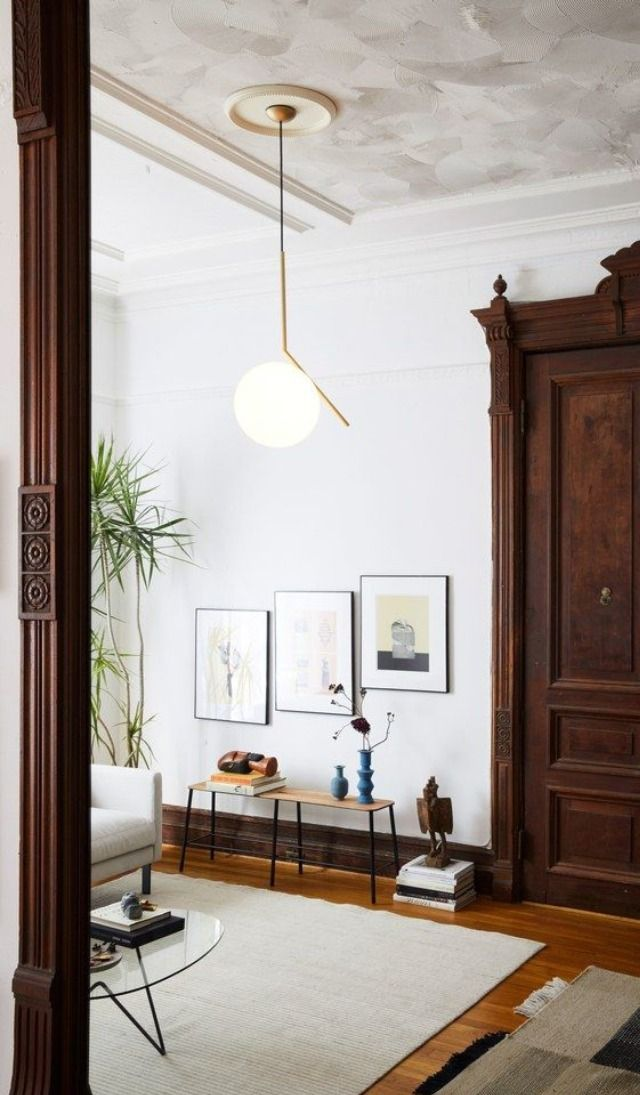 Minimal Orb Pendant Accents Vintage, New Traditional Living Room with Wood Armoire