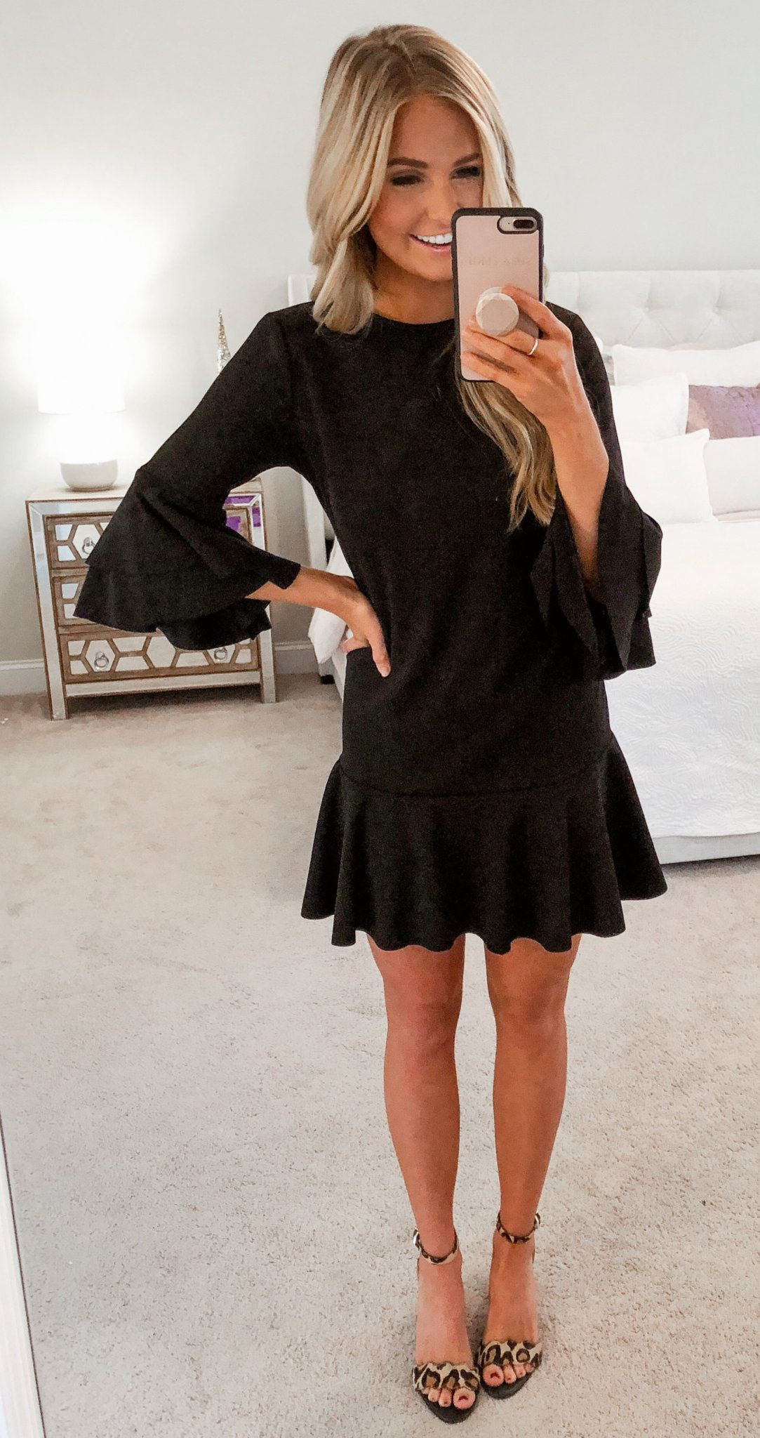 black crew-neck trumpet-sleeved dress