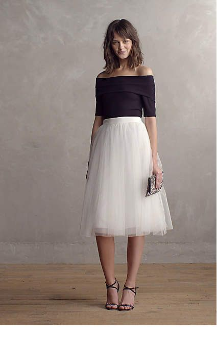 Black blouse and white tulle skirt