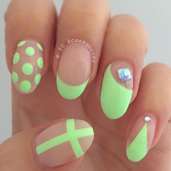Adorably cute neon green nail art in polka dot, French tip and cross designs topped with silver beads.