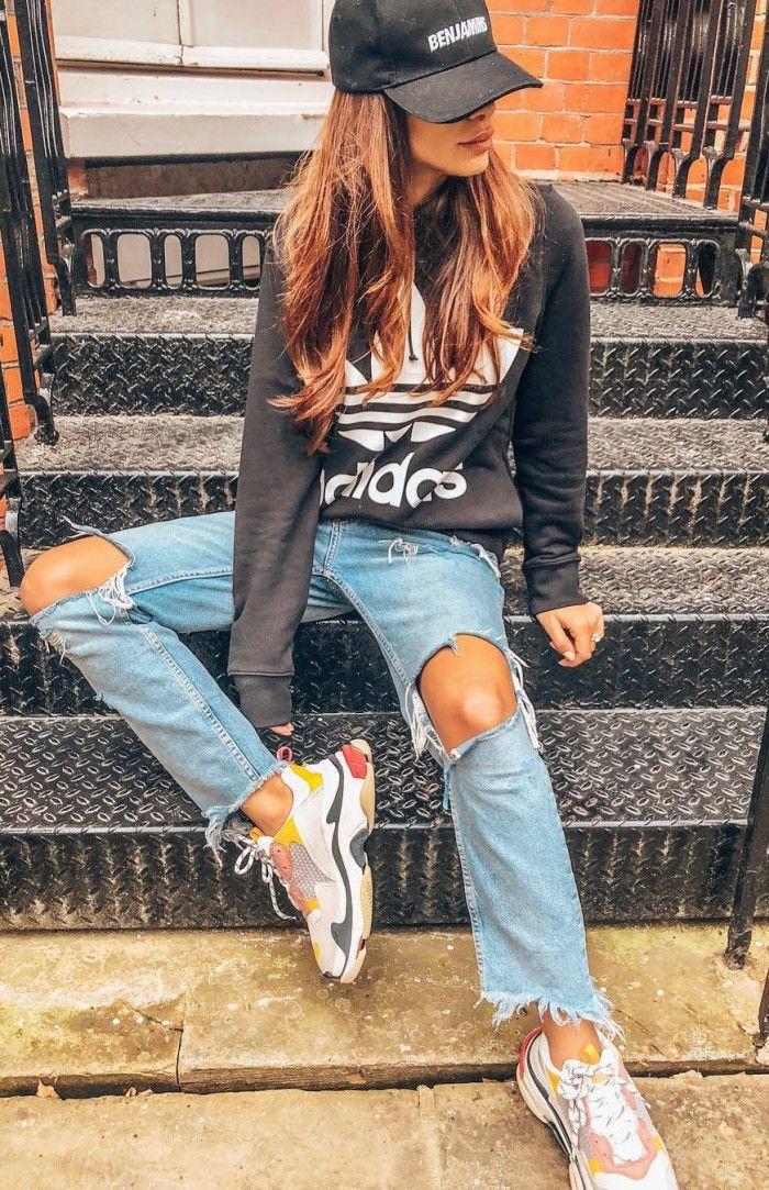 trendy outfit_hat sweatshirt distressed jeans sneakers