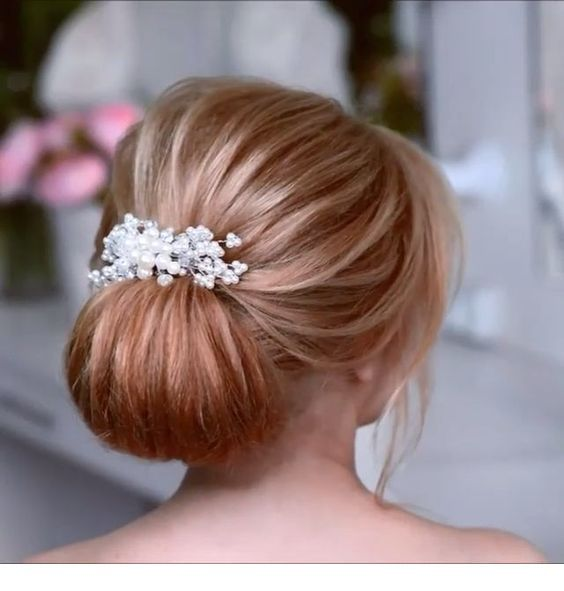 Cute bun with wedding accessory