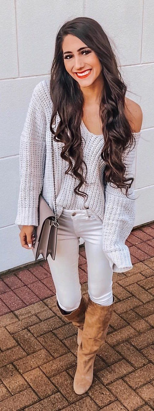 white off-shoulder sweater and white jeans and pair of knee-high boots